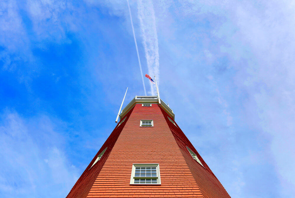 Architectural Photography of the Portland Observatory, upward view with blue sky in Portland, Maine