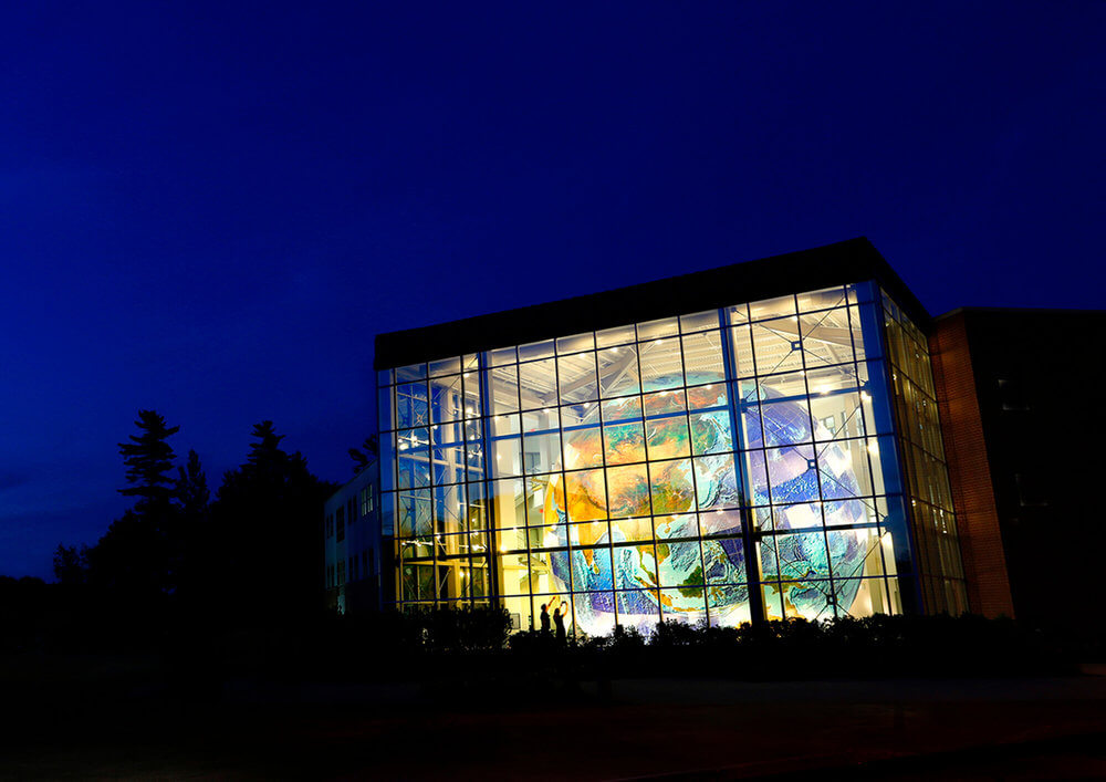 Architectural Photography Night exterior view of the Delorme Globe in Yarmouth, Maine
