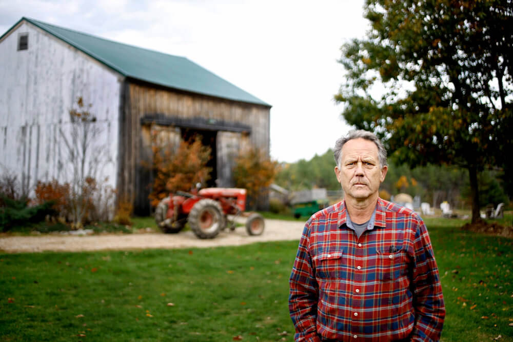 Portrait photography of Sam May, co-founder of the Maine Harvest Credit Project, at Broadturn Farm in Scarborough Maine