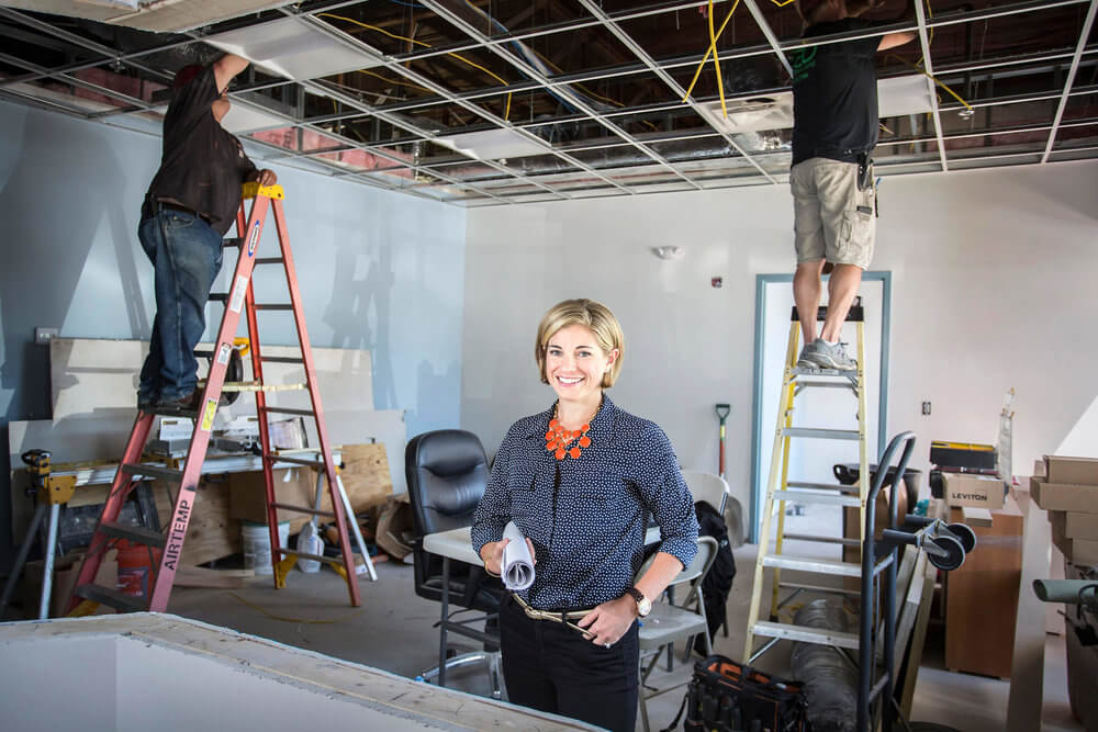 Portrait photography of Deirdre Wadsworth, president of Hardypond Construction, at the future home of New England Cancer in Scarborough Maine