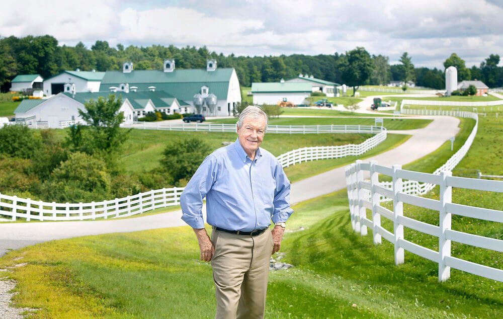 Portrait photography of Bill Haggett, Pineland Farms CEO, on the farm in New Gloucester Maine