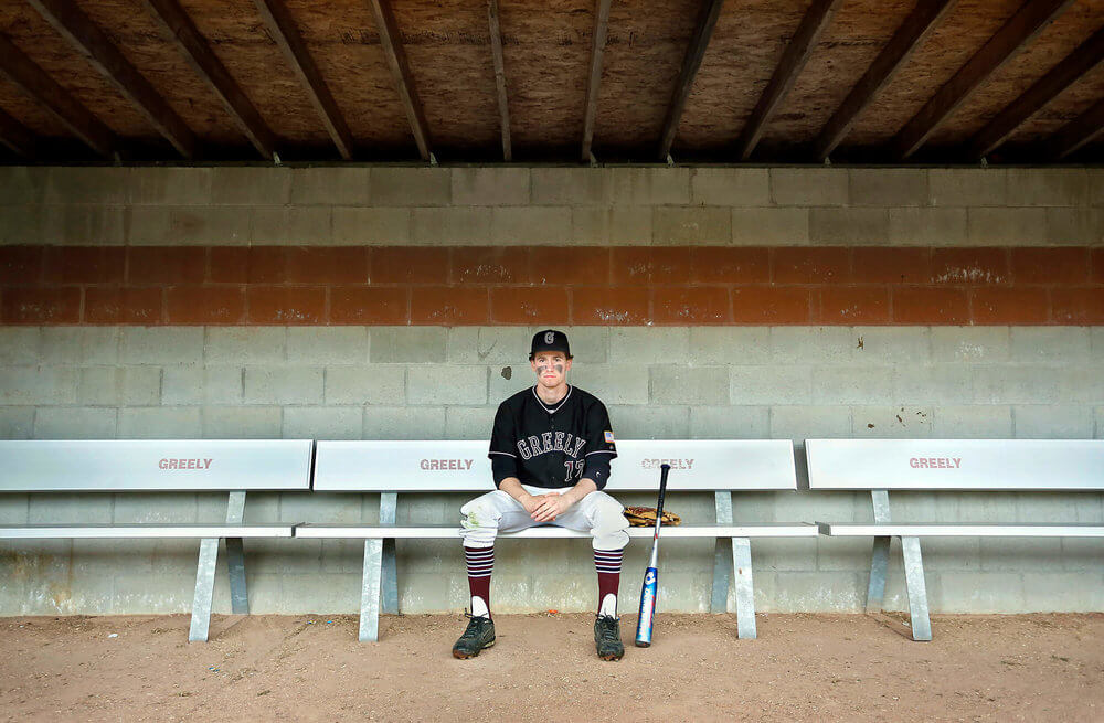 Portrait photography of Greely High School baseball player Sam Porter has overcome concussions from soccer to be a viable member of the team in Greely Maine