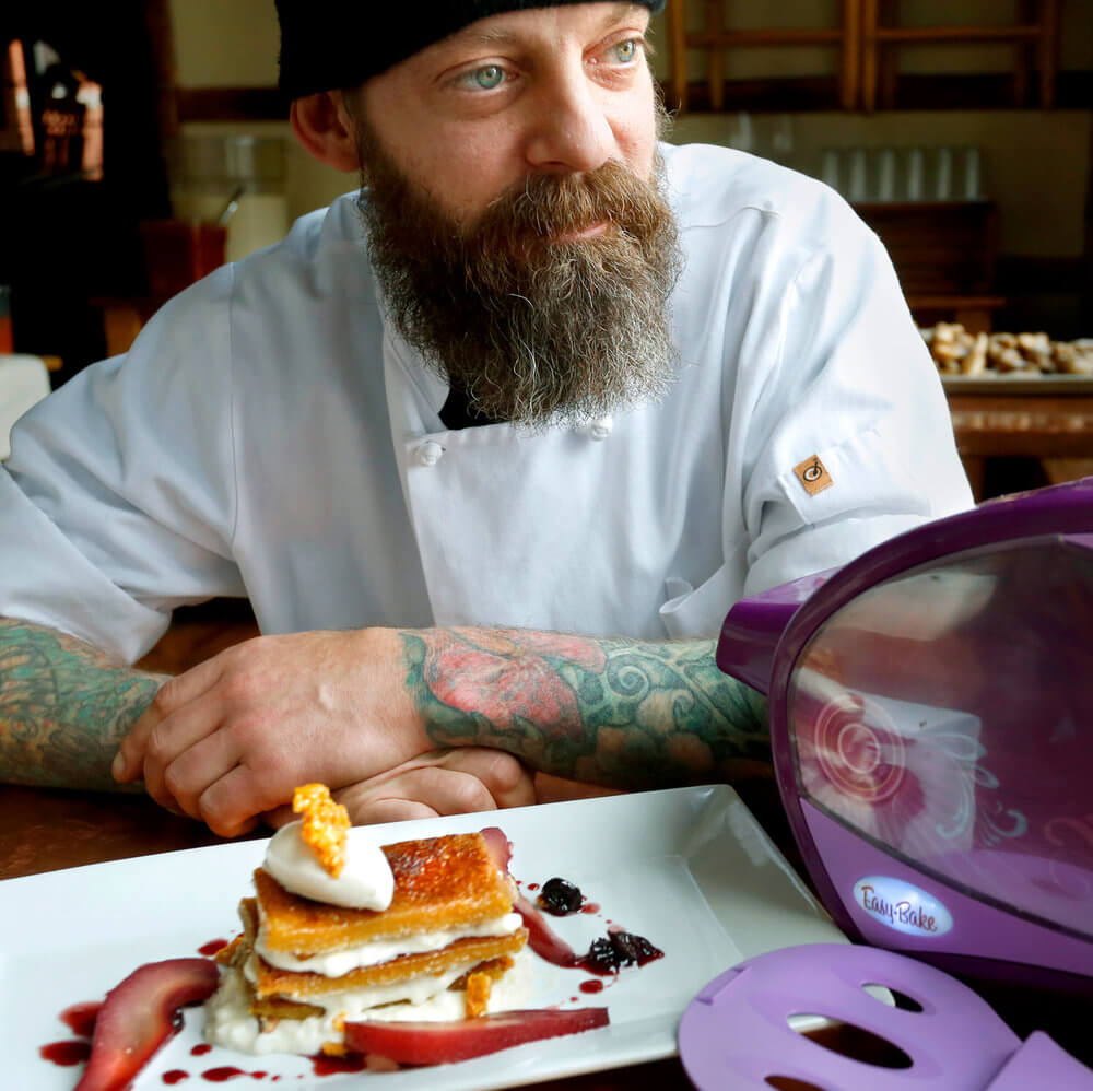 Portrait photography of Brant Dadaleares, a pastry chef at Fore Street, creates a  maple creme brulee napoleon at the restaurant. Dadaleares used an Easy Bake Oven to make a portion of the food.