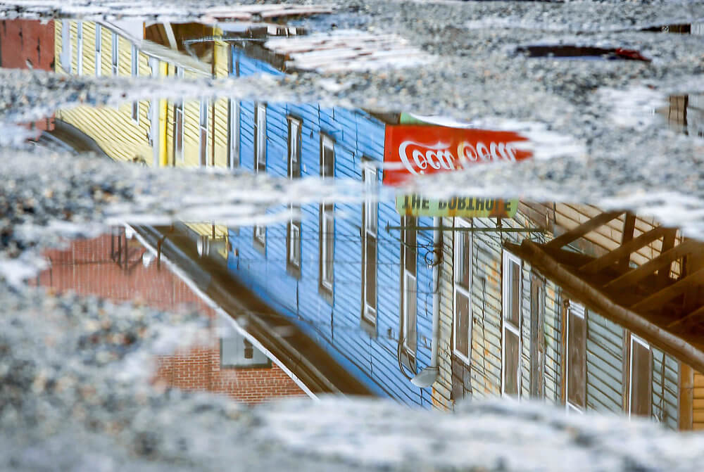 Maine photography of buildings reflecting off a puddle in Portland Maine