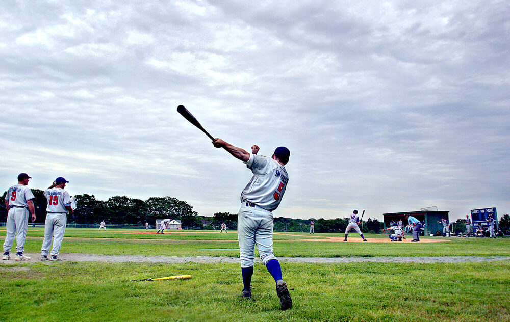Maine photography of a high school baseball player preparing to bat at a game in Portland Maine