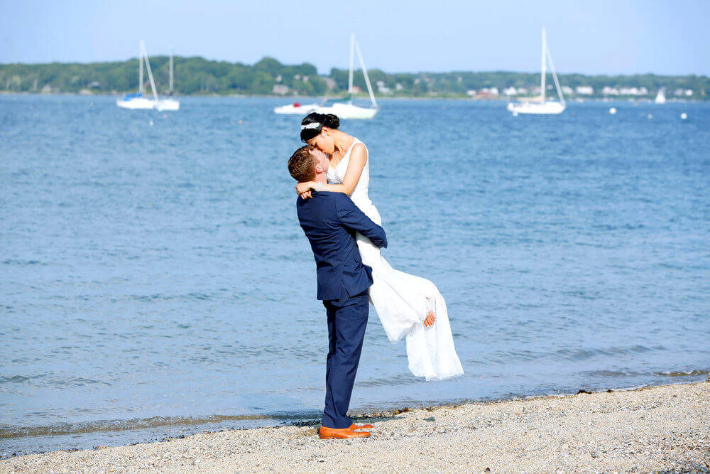 Wedding photography of couple hugging o the East End Beach in Portland Maine
