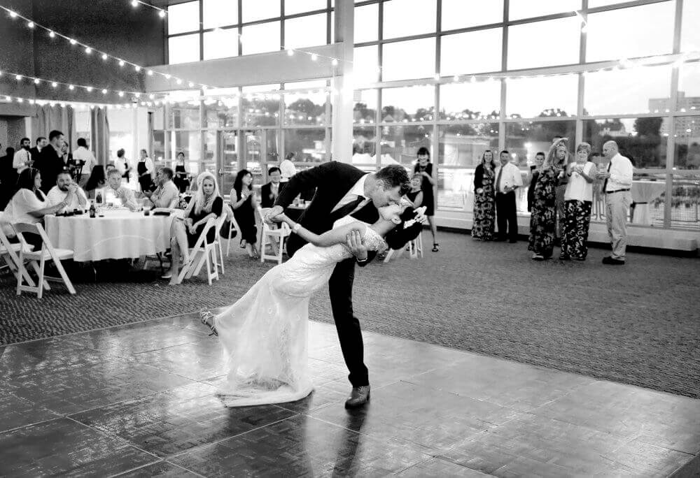 Black and white wedding photography of a bride and groom kissing at the end of their dance at Ocean Gateway in Portland Maine