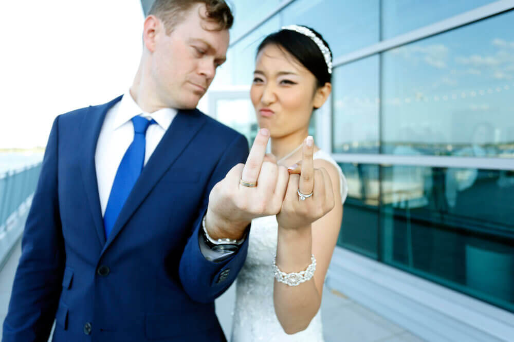 Wedding photography of a couple showing their wedding rings at Ocean Gateway in Portland Maine