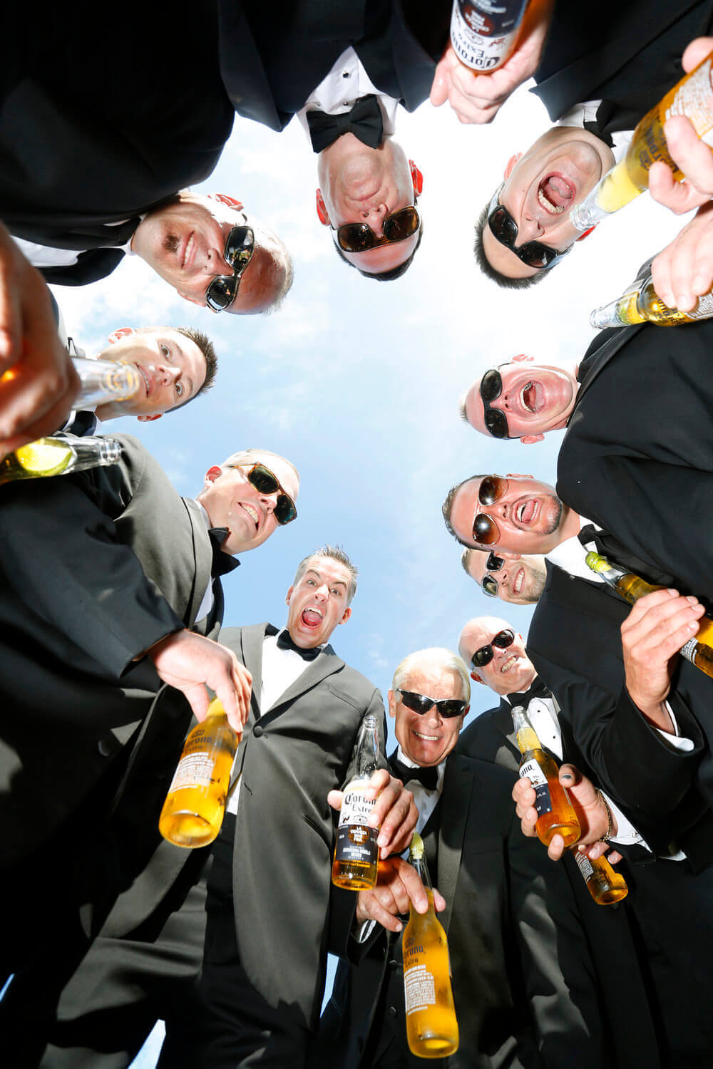 Wedding Photography of the groomsmen with their drinks in Kennebunkport Maine