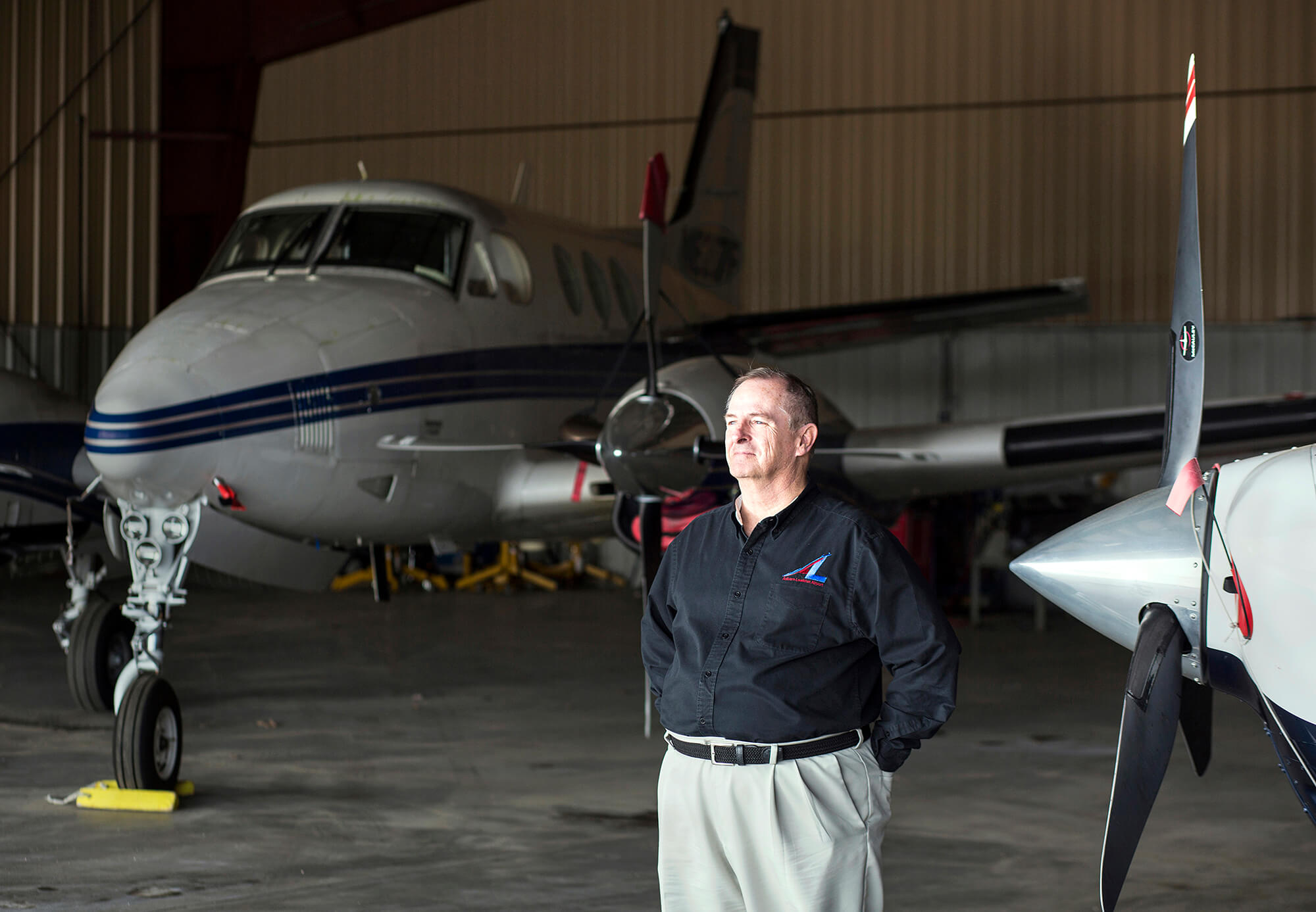 Portrait photography of Auburn-Lewiston Airport Director Rick Lanman in one of their hangars in Auburn Maine