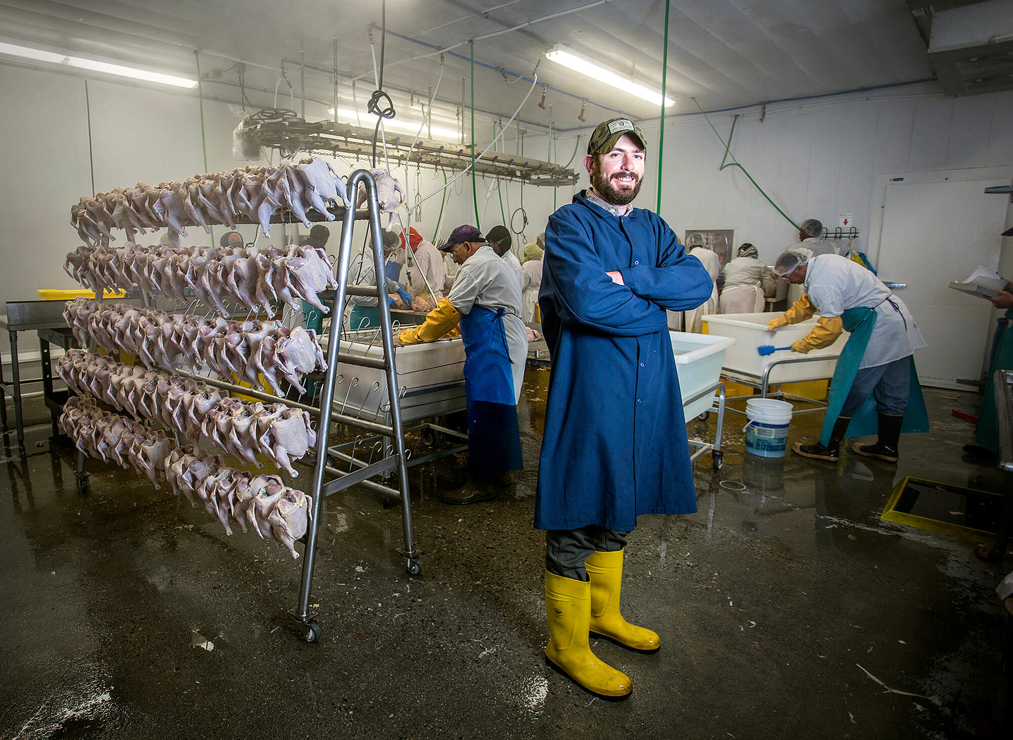 Portrait photography of Ryan Wilson, co-owner of Commonwealth Poultry Co., in their facility in Gardiner Maine