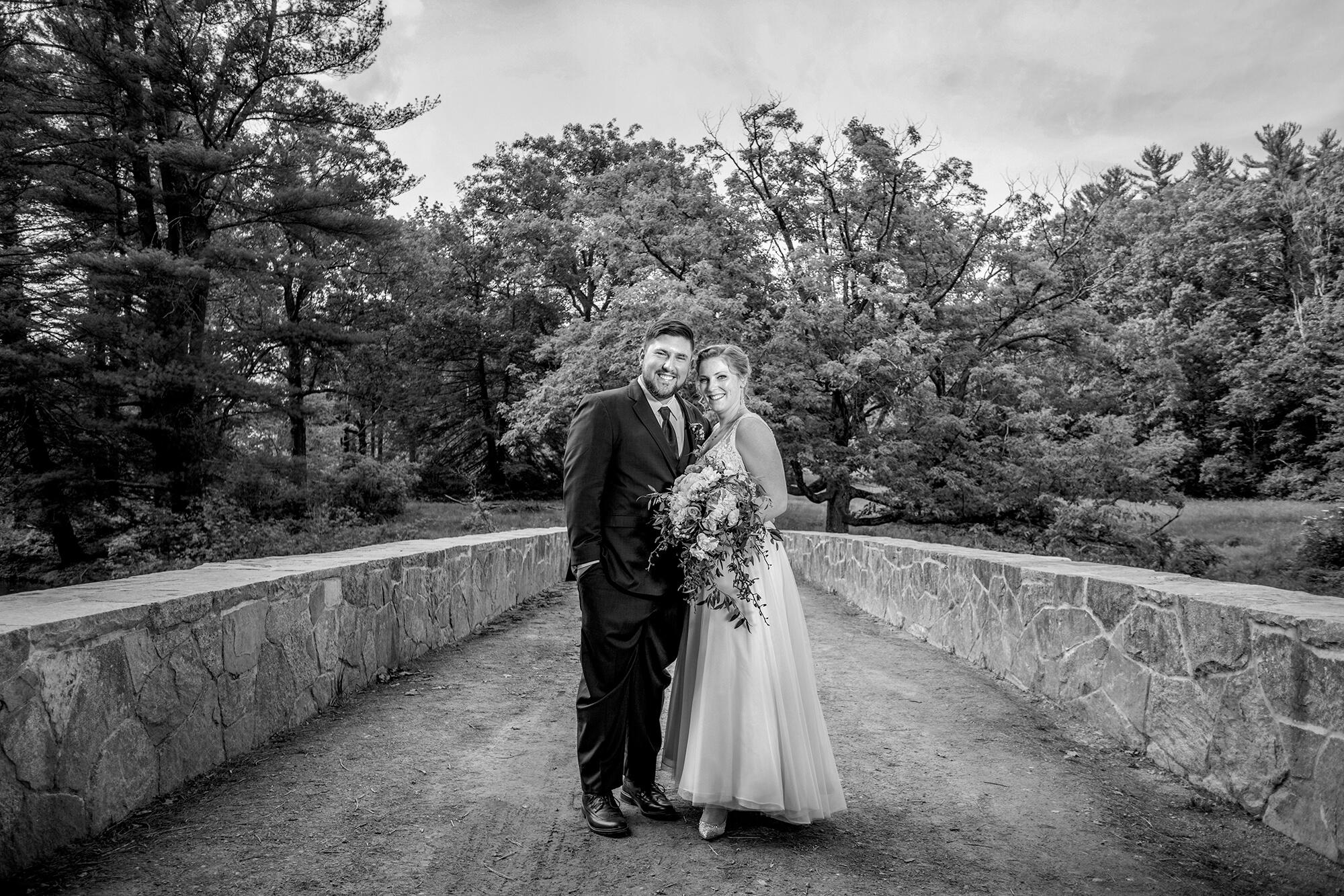 Wedding photography of the couple on a stone bridge