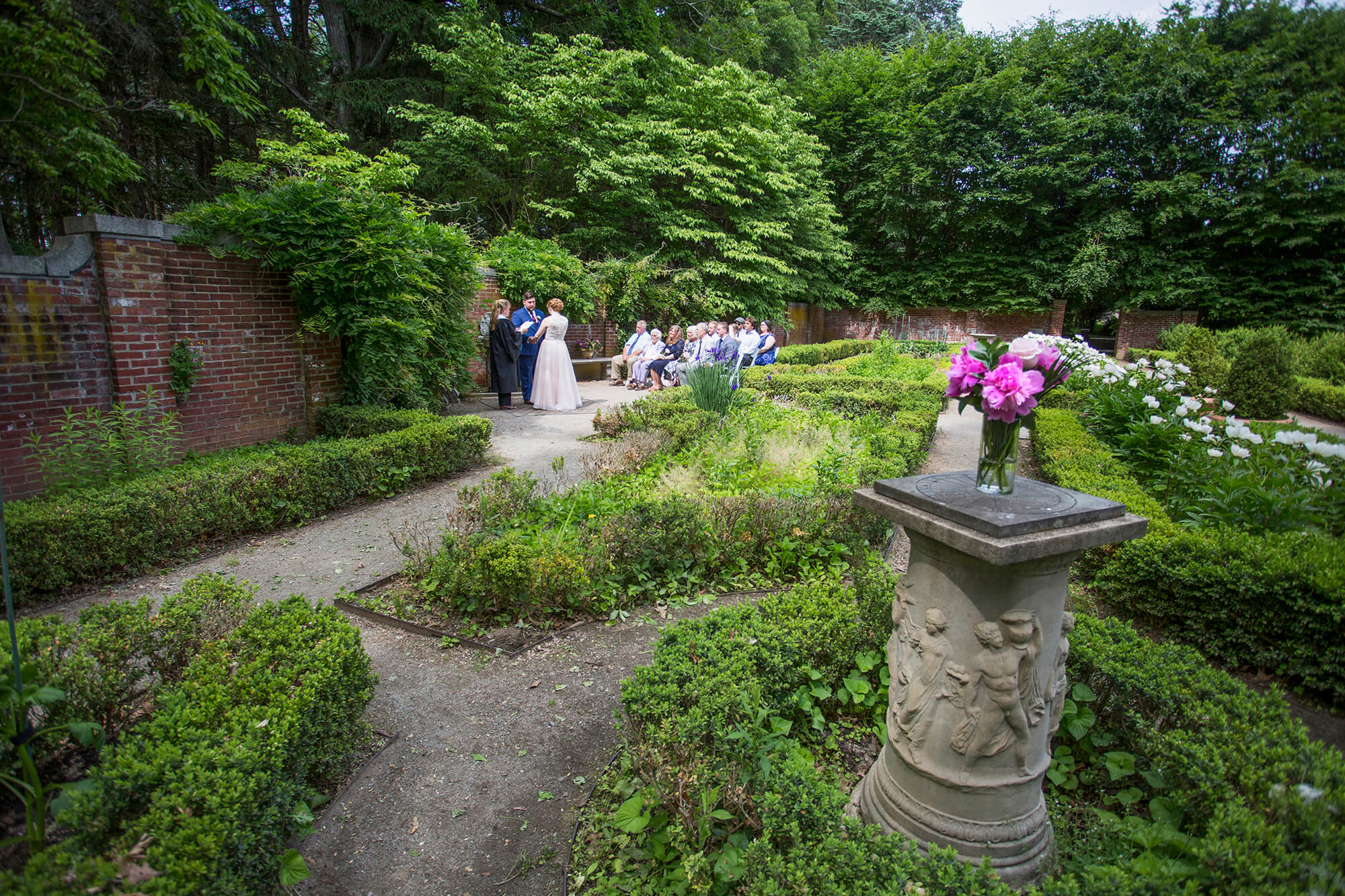 Wedding photography of a ceremony in a flower garden in New Hampshire