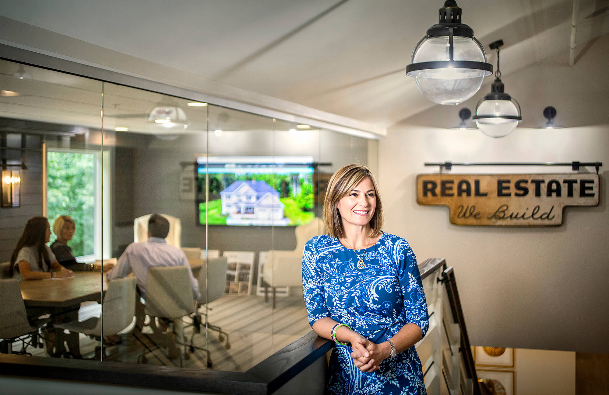 Portrait photography of Dava Davin, owner of Portside Real Estate Group, in their Falmouth office