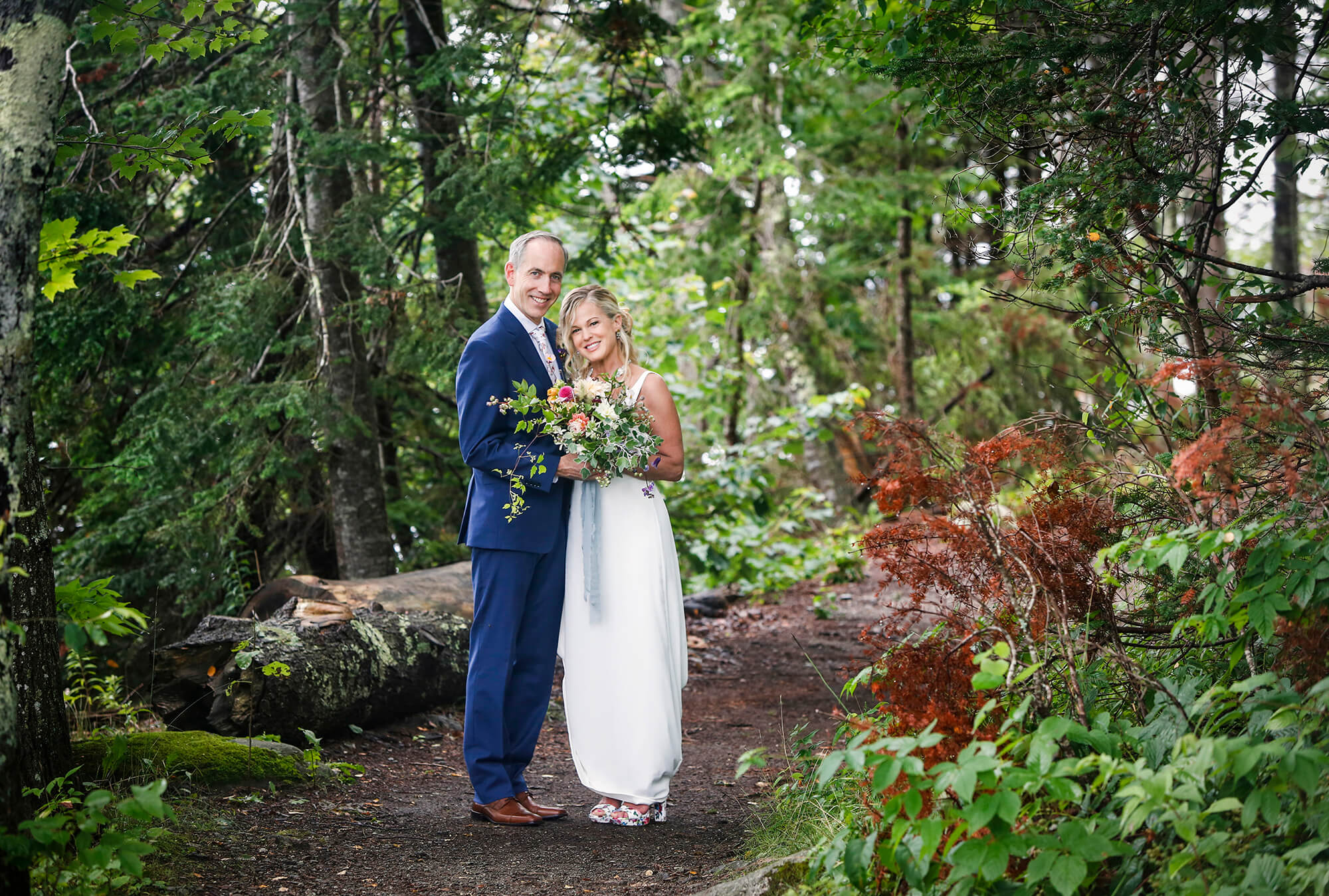 Wedding photography of a couple on a trail in the woods