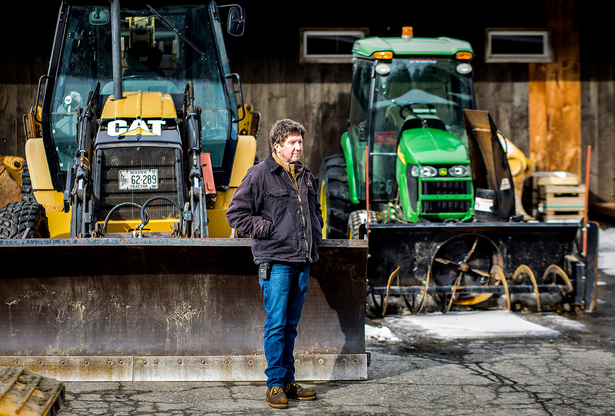 Portrait photography of Scott Dugas, president of Scott Dugas Trucking and Excavating, at their Yarmouth facility