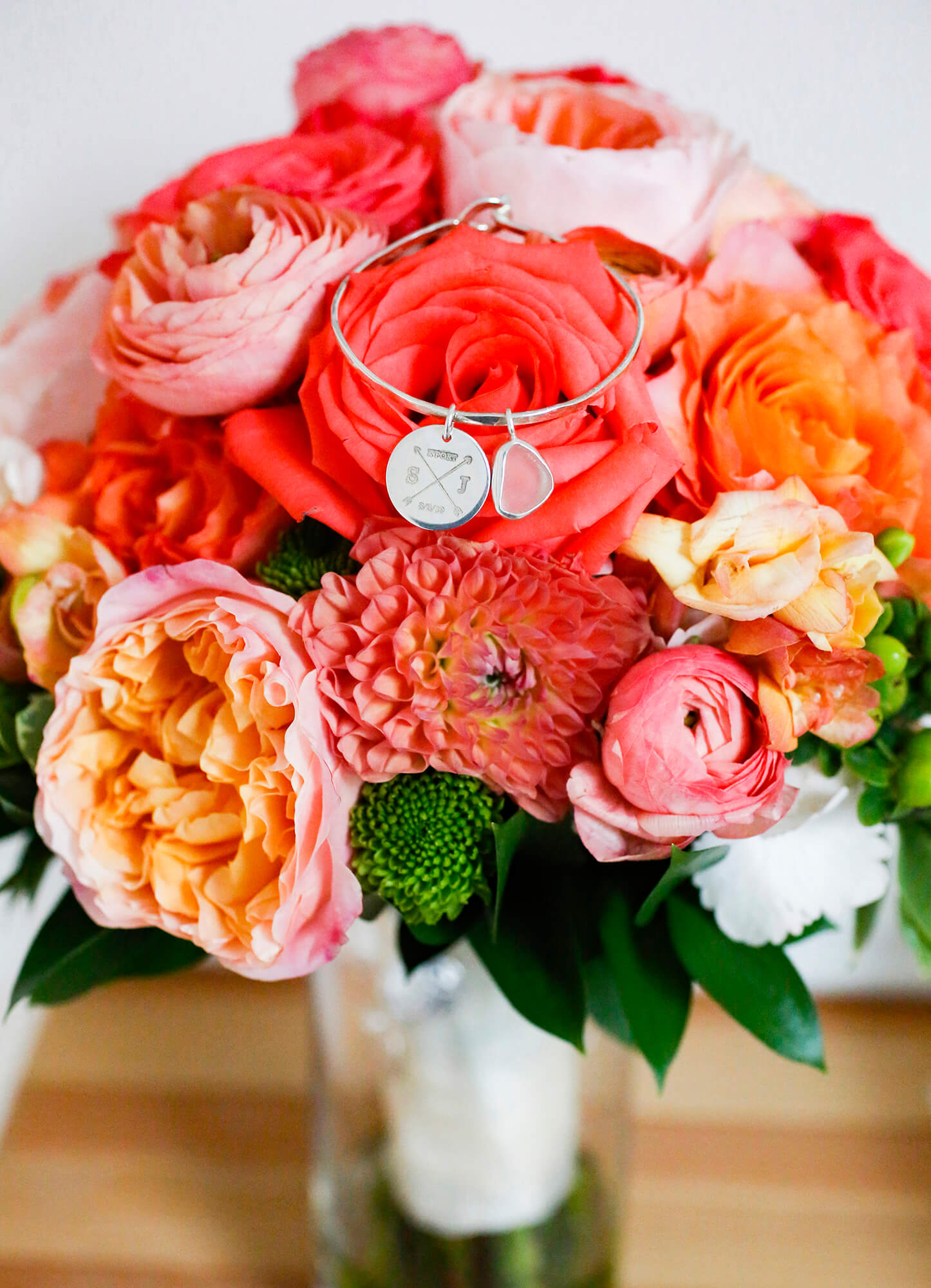 Wedding photography of a bouquet of red and pick flowers
