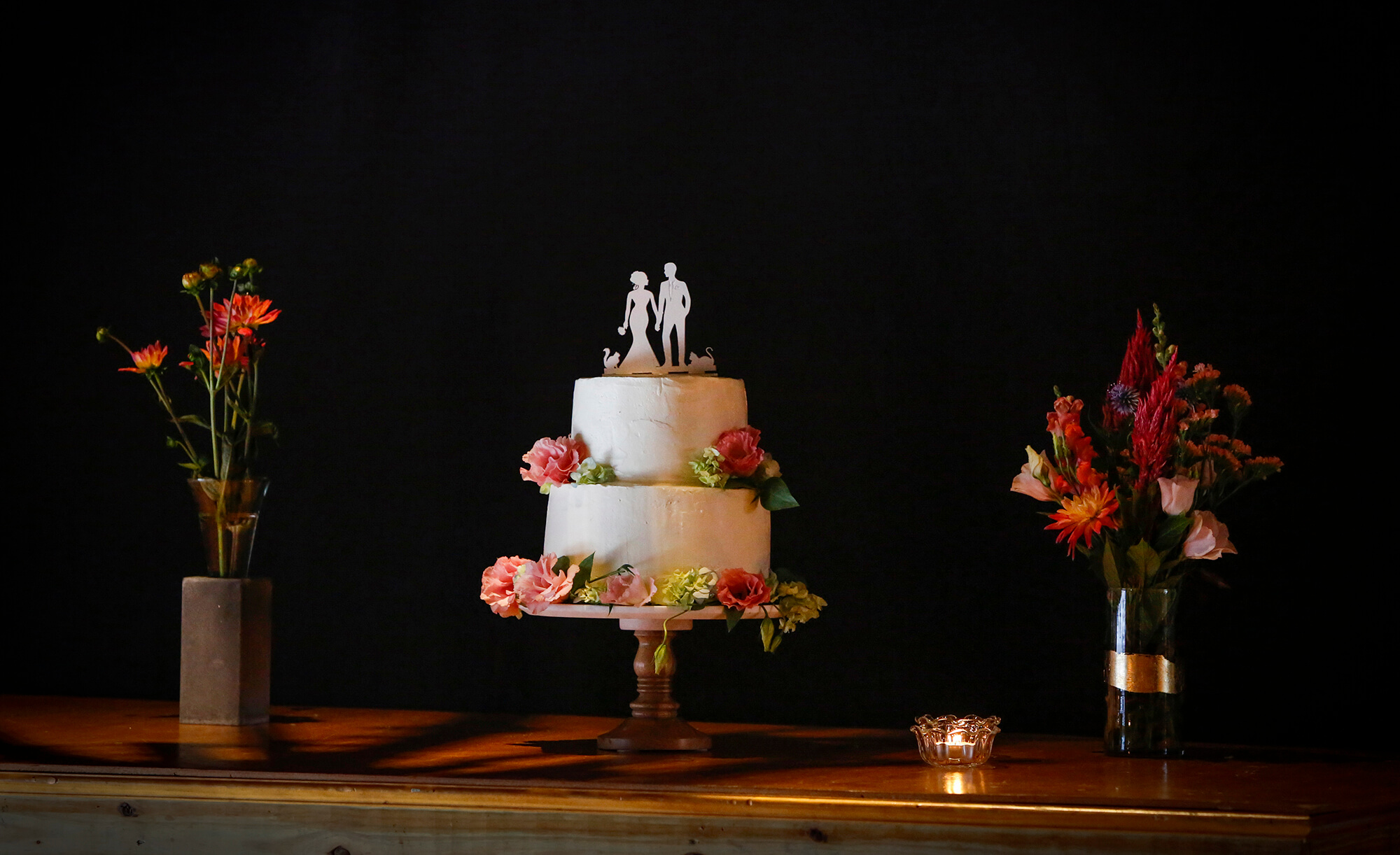 Wedding photography of the wedding cake and flowers in Portland Maine