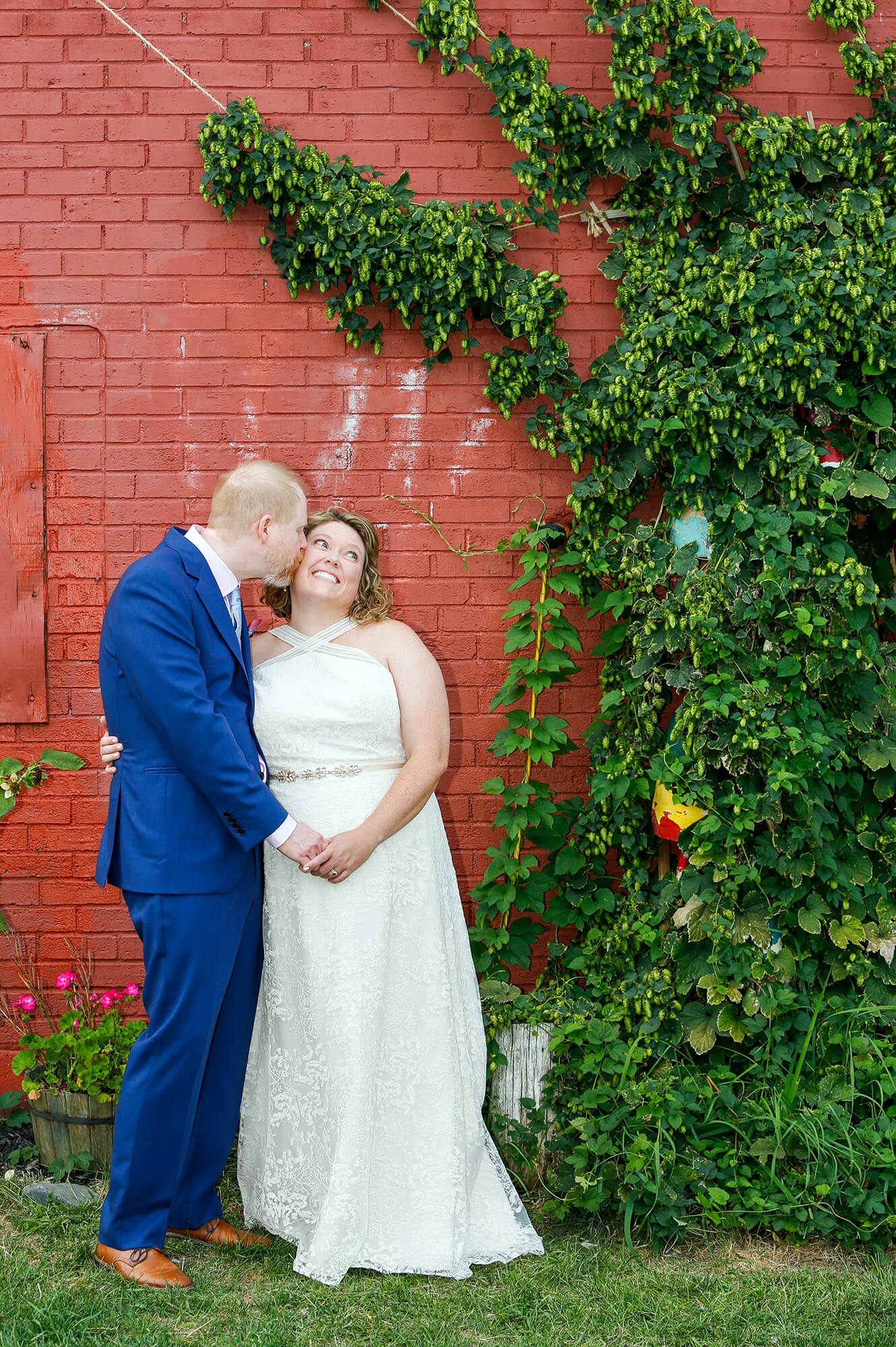 Wedding photography of a couple in front a of a red wall in Portland Maine