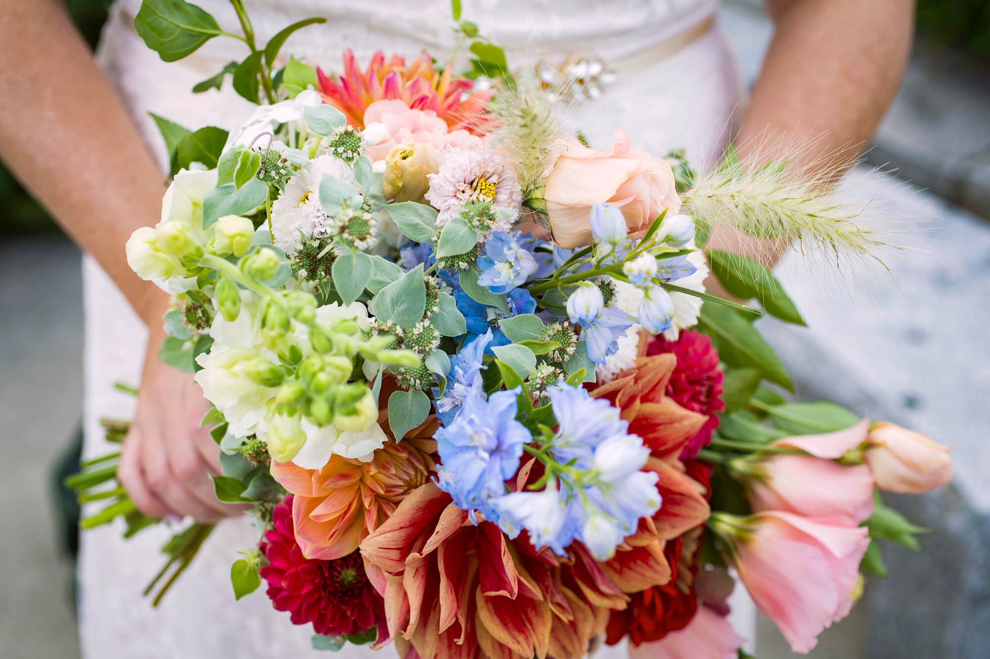 Wedding photography of a bouquet being held by the bride