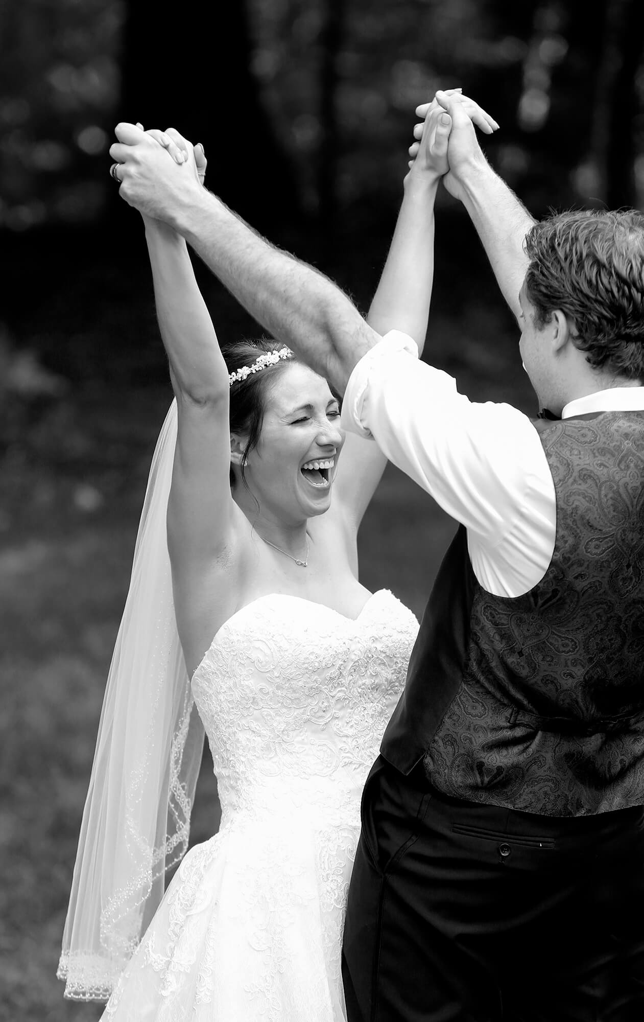 Wedding photography of the bride celebrating after the first dance with her new husband