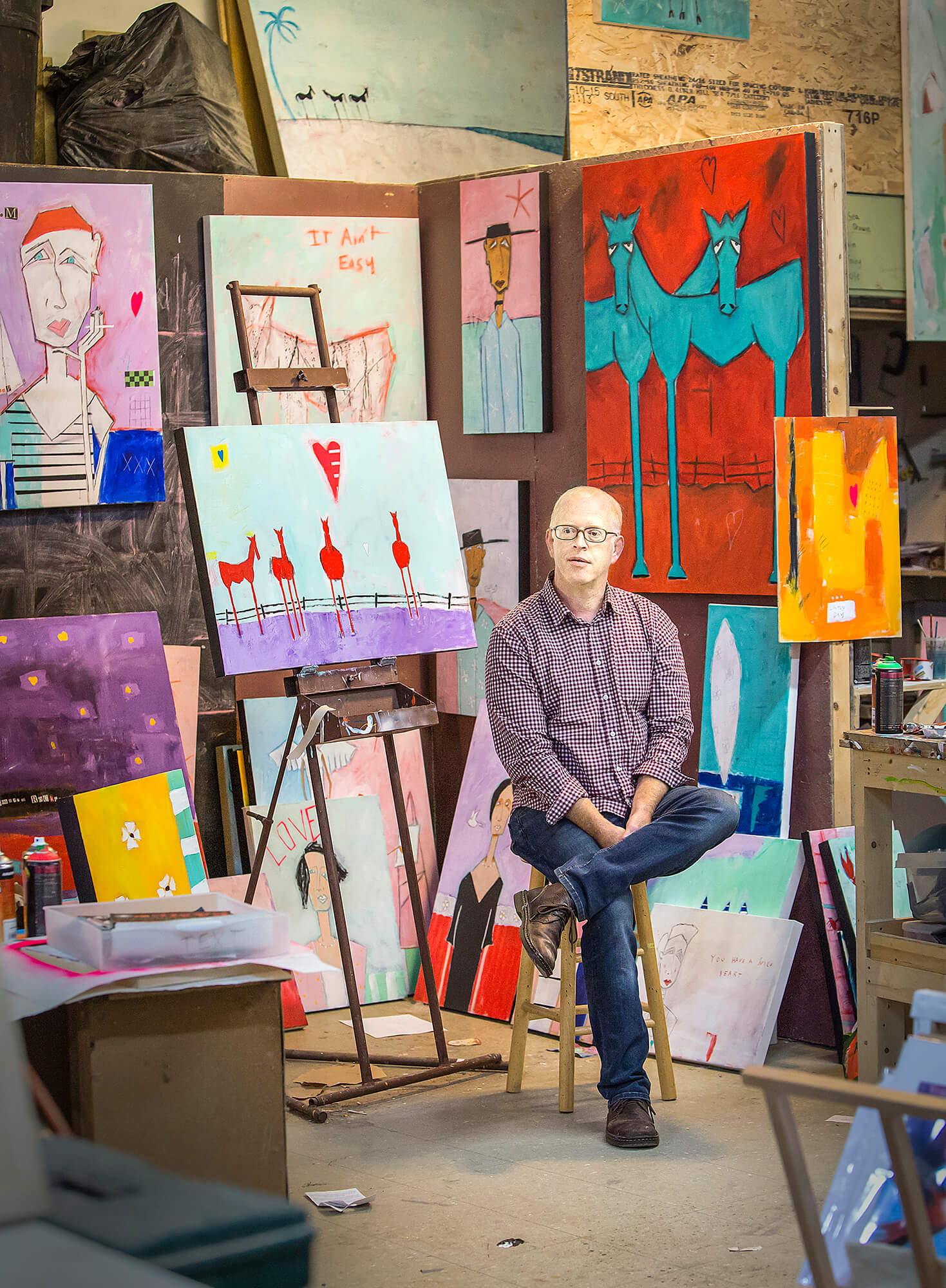 Portrait photography of Portland painter Rick Hamilton in his studio