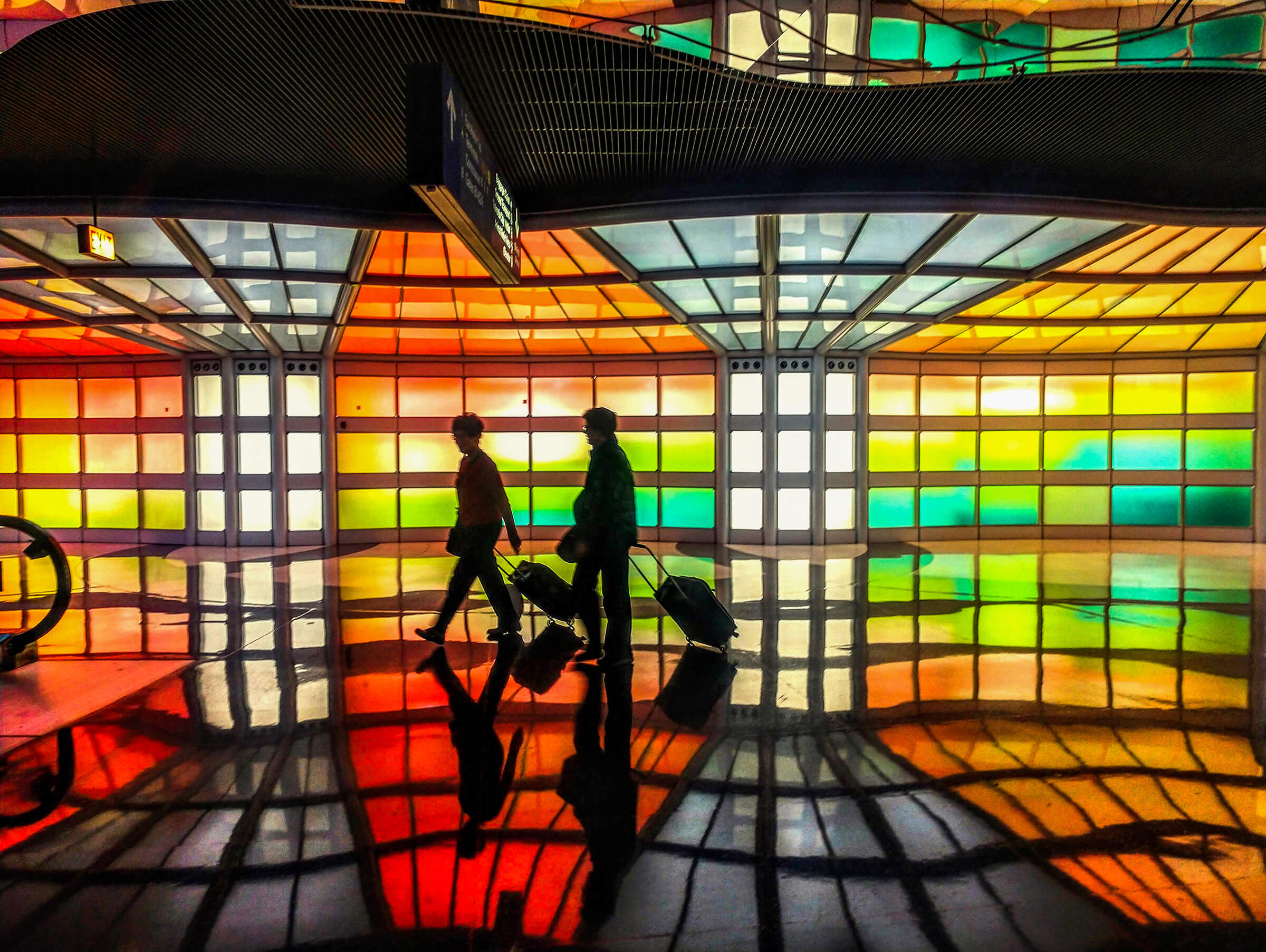 Architectural Photography Chicago O'Hare Airport, people walk through a colorful terminal